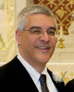 John Edward  Koury
