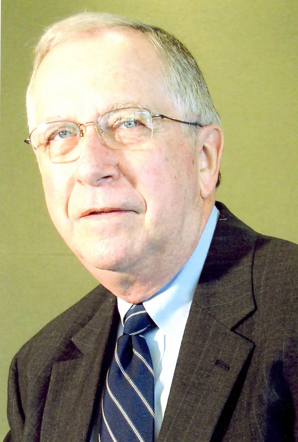 Dr. Joseph E.  Champagne