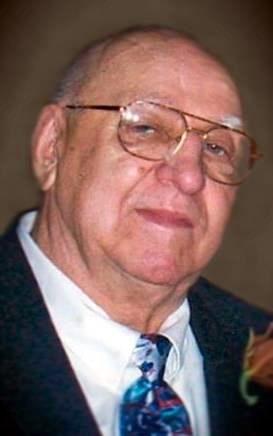 John D.  Traczyk