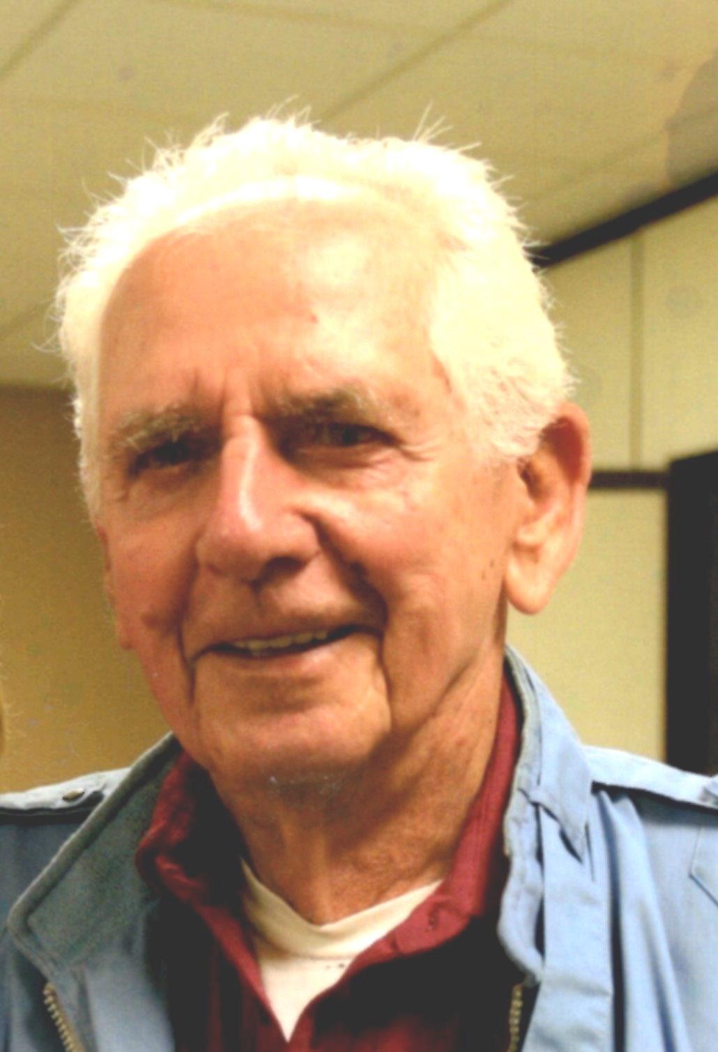 John F.  Yuhasz