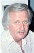 Charles J.  Riha
